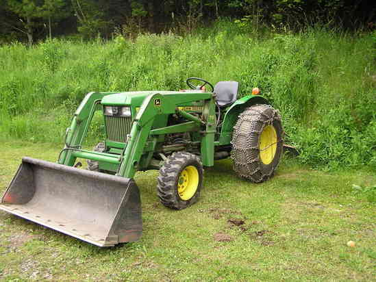 whats a good compact tractor can anyone identify this john deere tractor steel hood and looks upper range of compact steel curved fenders 1050 950