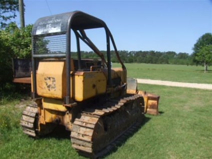 What do you give up when you convert a dozer from steel tracks to