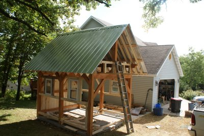 started the board and batten siding framed in some windows