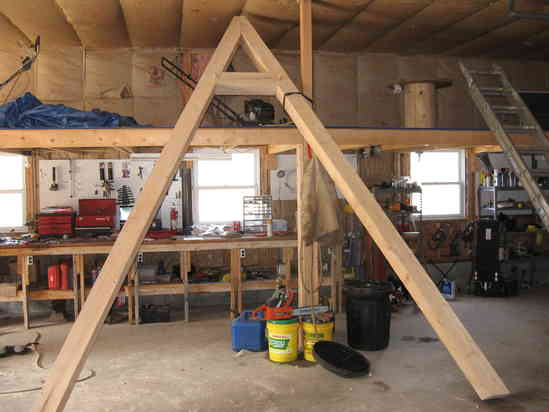 the legs are 6x6 the top beam is 8x8 octagon the angle braces are 3x5 and its bolted to concrete pillars at ground level